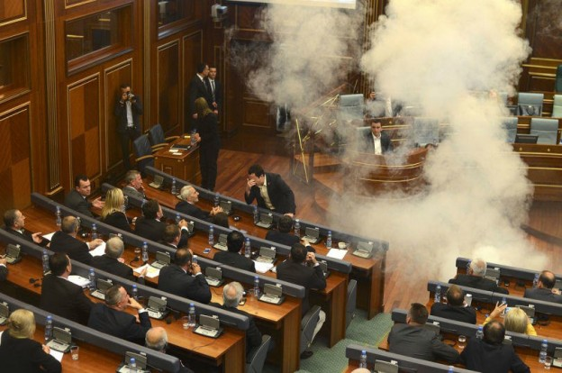 Tear gas and eggs in Kosovo's parliament