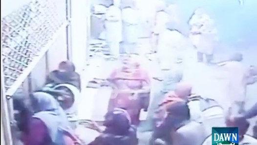 CCTV footage of 20 people looting a shop