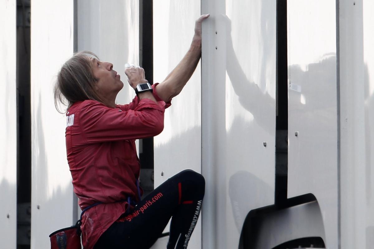 French 'Spiderman' scales Paris skyscraper