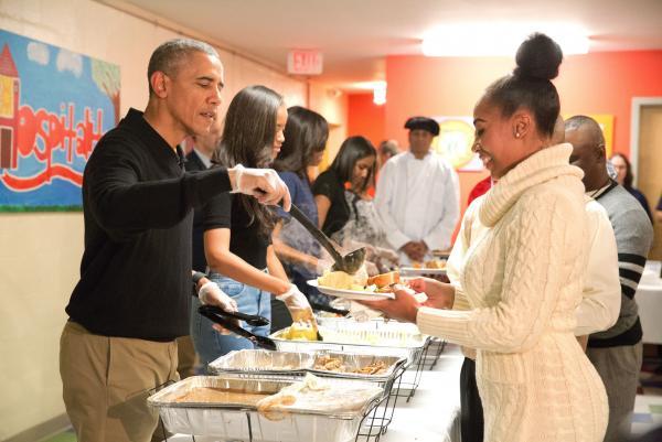 Obama family serves dinner to homeless