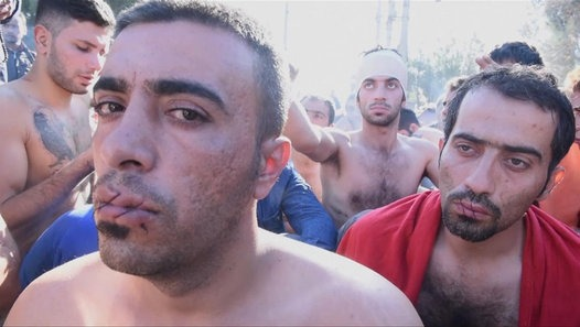 Refugees sew their mouths shut in protest