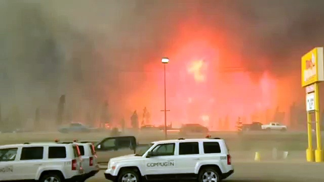 Massive Canada Wildfire Spreads South Forcing More Evacuations