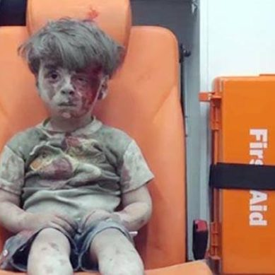 Child Pulled From Rubble After Airstrike In Syria