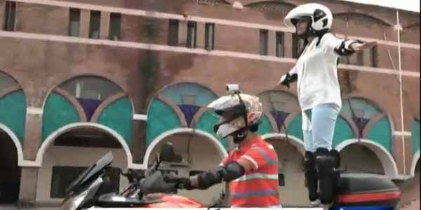 Female in Lahore performs stunts on a heavy bike