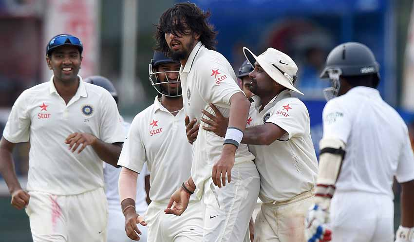 Indian cricketer Ishant Sharma (C) celebrates with teammates after dismissing Sri Lankan cricketer Dinesh Chandimal during the fourth day of their third and final Test cricket match between Sri Lanka and India at the Sinhalese Sports Club (SSC) in Colombo on August 31, 2015. AFP PHOTO / Ishara S. KODIKARA        (Photo credit should read Ishara S.KODIKARA/AFP/Getty Images)