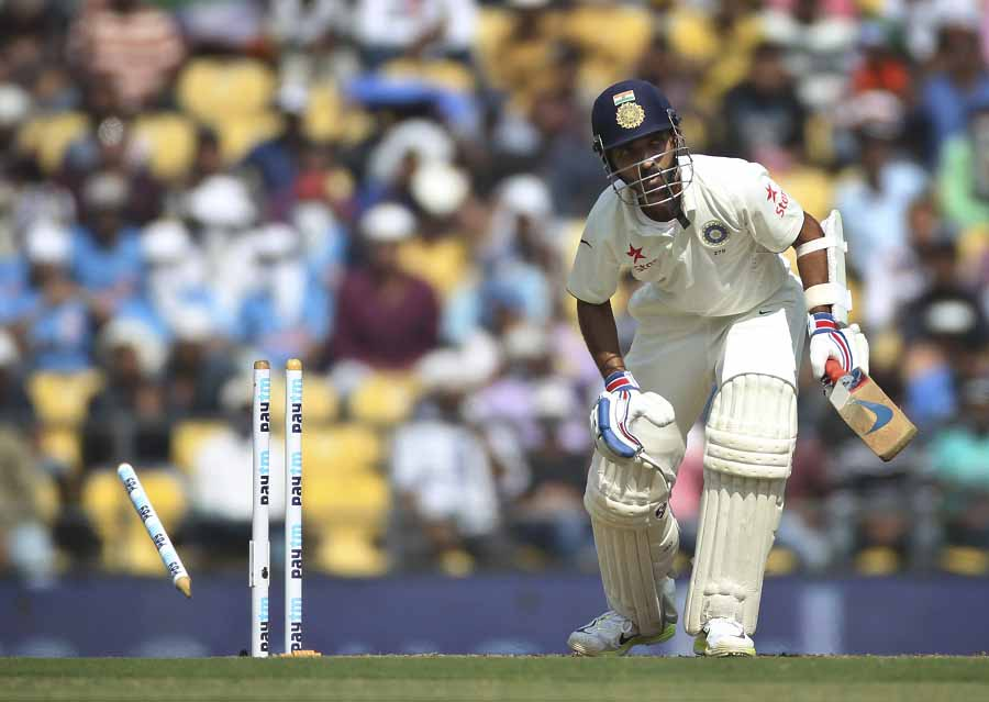 Indian batsman Ajinkya Rahane reacts as he is bowled while playing against South Africa on the first day of the third test match between the two countries in Nagpur, India, Wednesday, Nov. 25, 2015.(AP Photo/Rafiq Maqbool)
