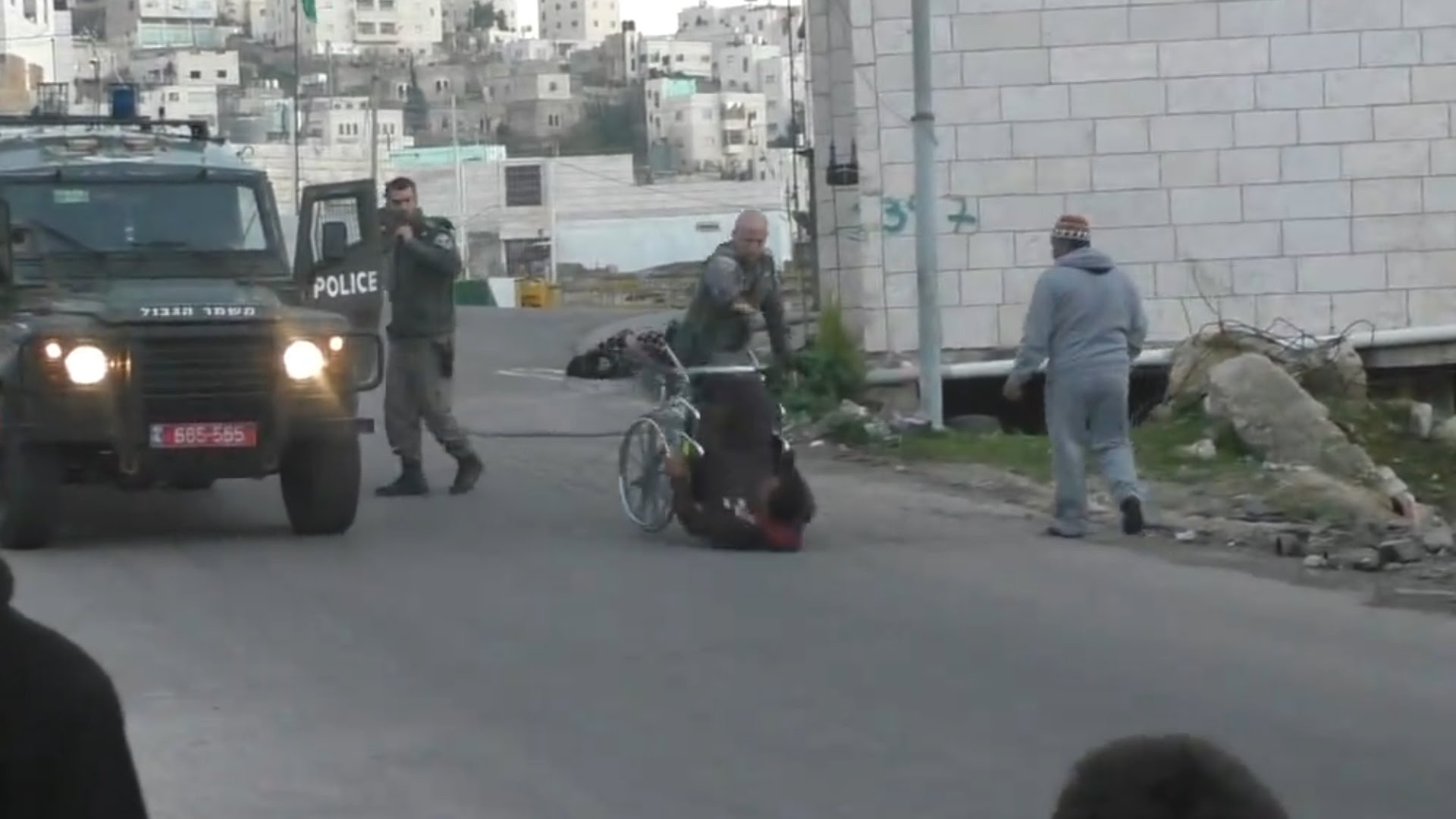 Israeli Border Police Officer Flips Over Man In Wheelchair
