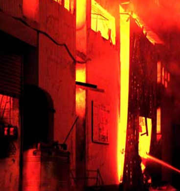 Fire At Karachi's Wood Warehouse Drenched