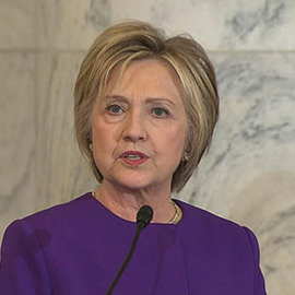 Clinton Jokes At Her Own Expense For Reid's Retirement