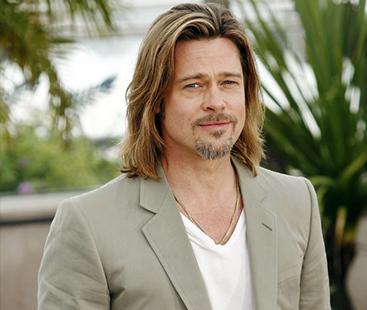 Brad Pitt Attends Charity Show