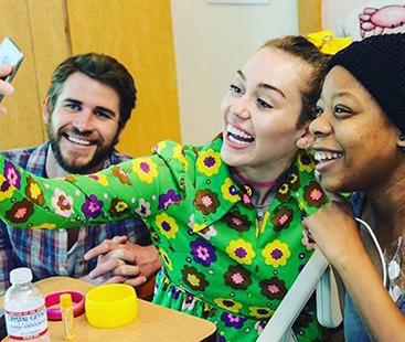 Miley & Liam Make Surprise Visit To Children's Hospital