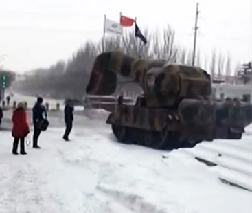 China Is Fighting Off The Snow With A Massive Tank