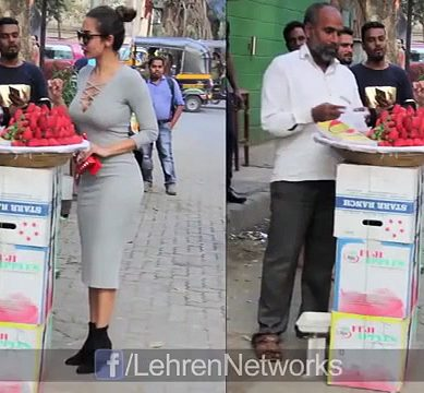 An Actress Stops By A Street-Side Vendor To Buy Strawberries