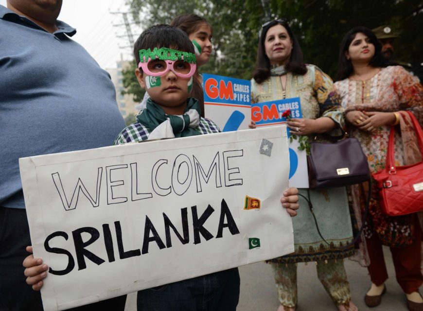 A boy holds a welcoming placard as he arrives prior to the start of the T20 cricket match playing between Pakistan and Sri Lanka at the Gaddafi Cricket Stadium in Lahore. Photo: AFP