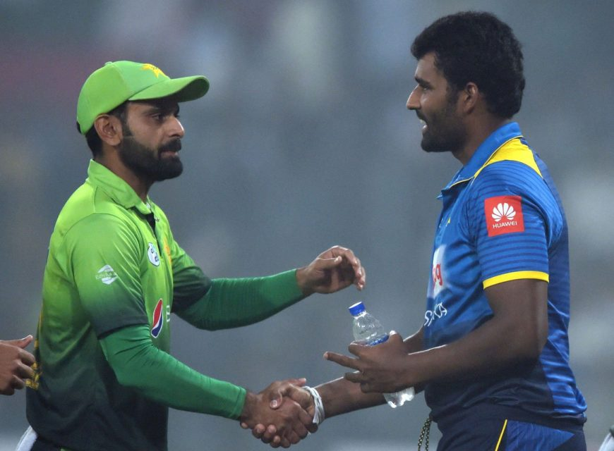 Sri Lankan cricket captain Thisara Perera (right) shakes hands with Pakistani cricketer Mohammad Hafeez (left) after the victory of Pakistan during the third and final T20 cricket match against Sri Lanka. Photo: AFP