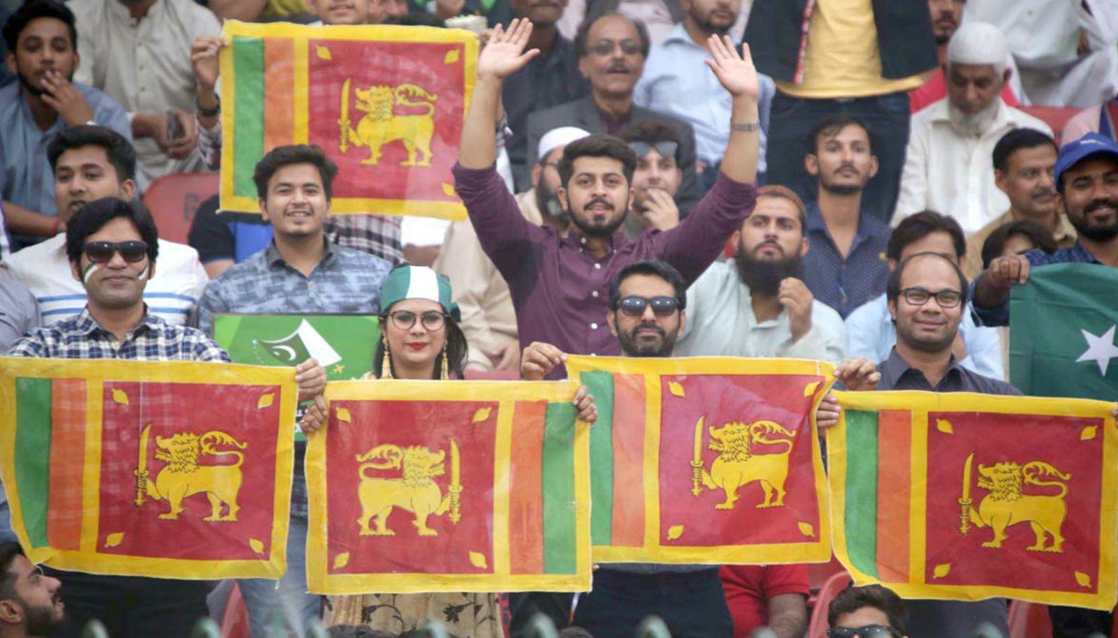 Spectators carrying Sri Lankan flags while watching third and last T20 International cricket match between Pakistan and Sri Lanka at Gaddafi Stadium. Photo: APP