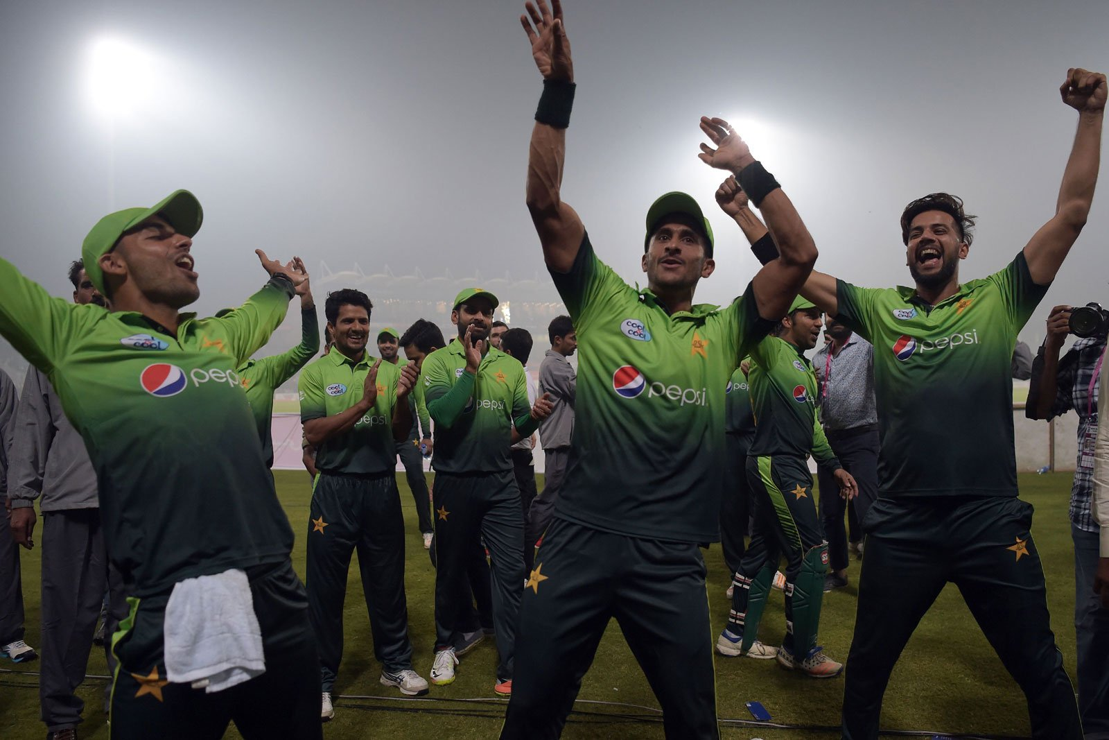 Pakistani cricket players celebrate after winning the third and final T20 cricket match against Sri Lanka at  Gaddafi Cricket Stadium in Lahore. Photo: AFP