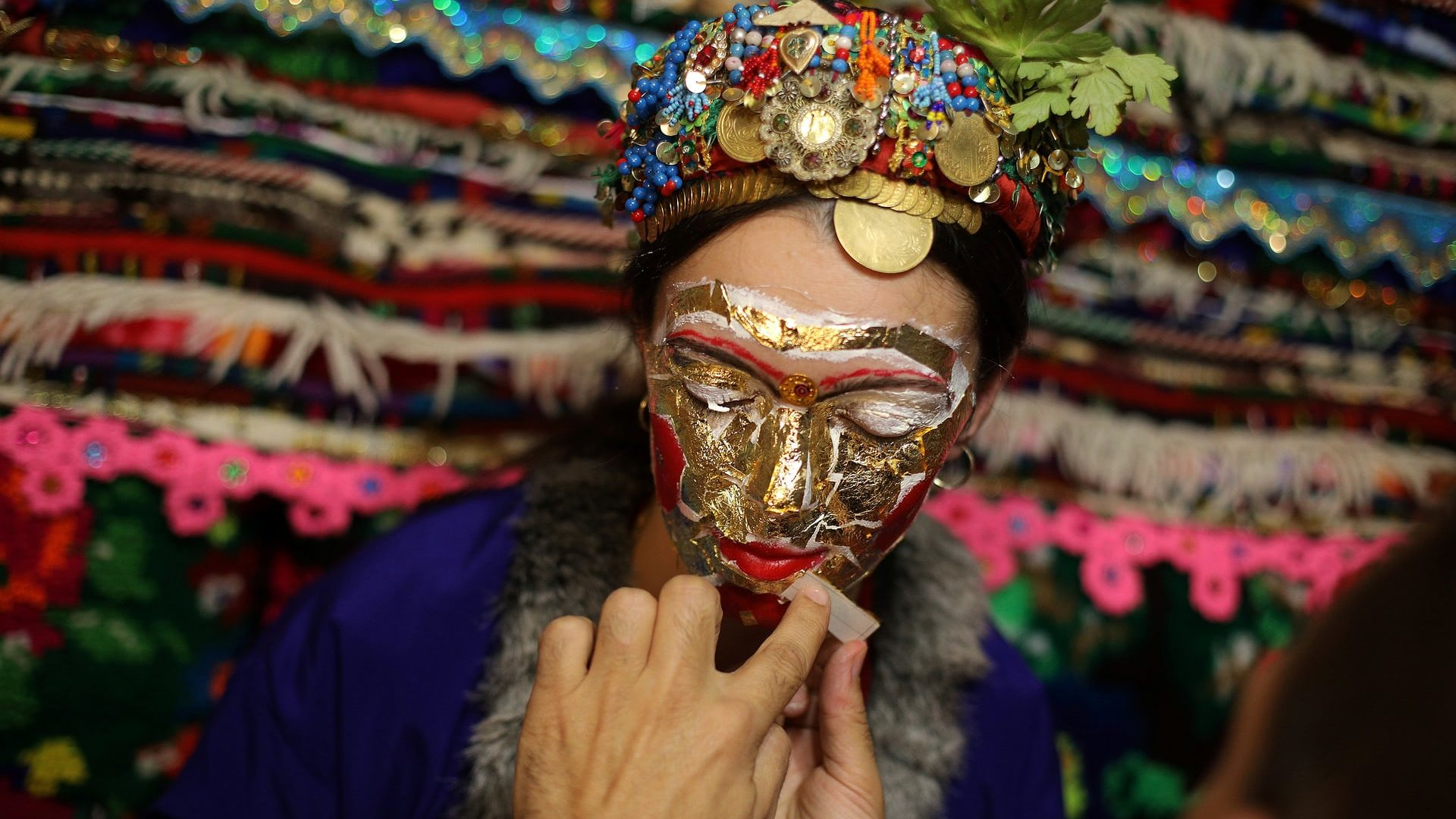 'Ghelina' makeup is applied to the face of Lilova, a Bulgarian Muslim, during her wedding ceremony Photograph: Stoyan Nenov/Reuters