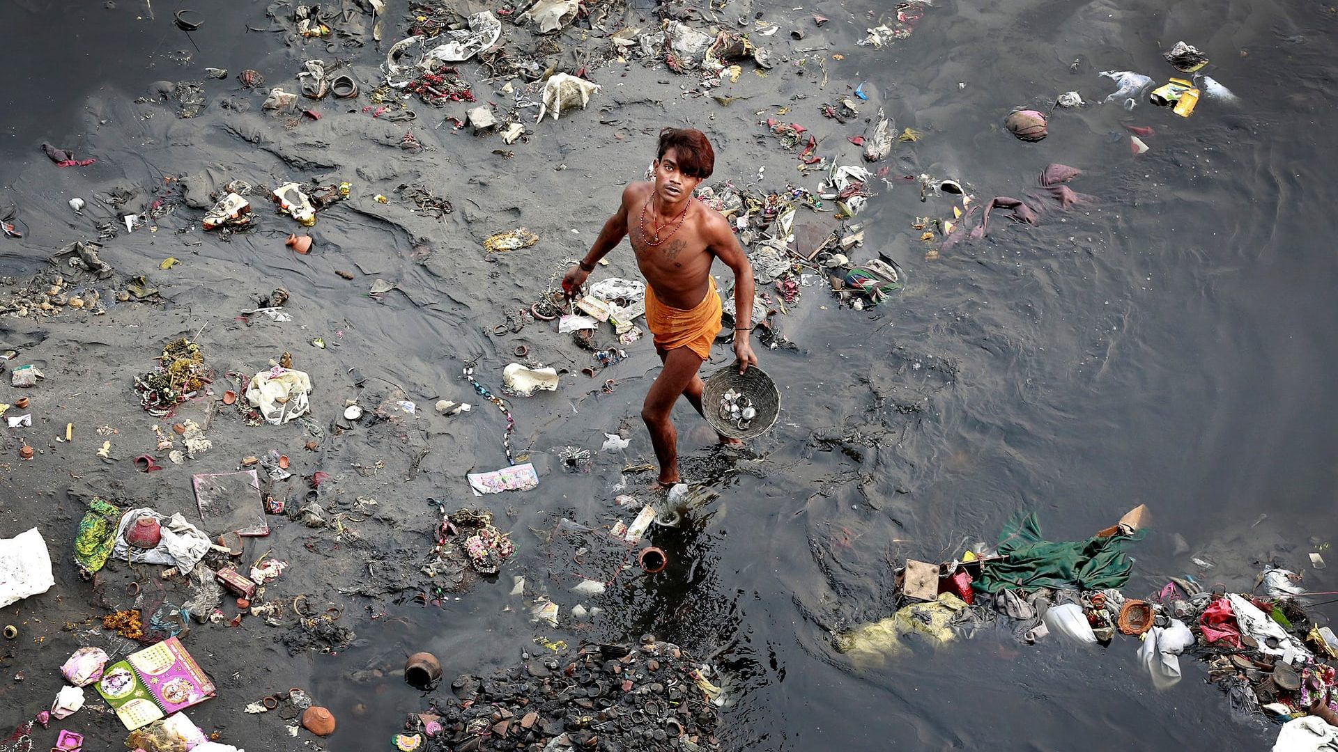 New Delhi, India A man sifts through rubbish in the Yamuna, India's most polluted river Photograph: Cathal Mcnaughton/Reuters