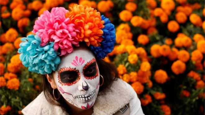 Hundreds of people dressed up as skeletons to take part in a parade celebrating the dead. They were surrounded by marigolds, a flower which is thought to guide the spirit of the dead with its vivid colours and scent.