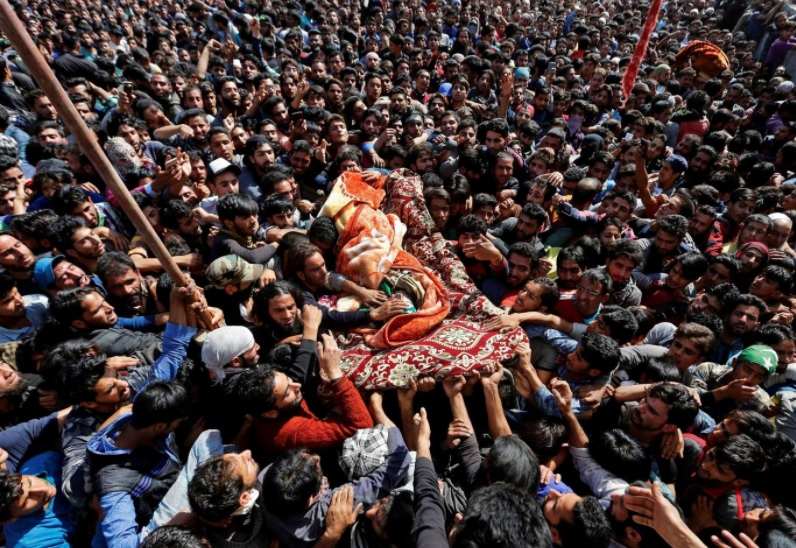 Waseem Shah, a suspected militant commander - People carry the remains of Waseem Shah, a suspected militant commander, who according to the local media was killed during a gunbattle with Indian security forces in Pulwama district in Kashmir