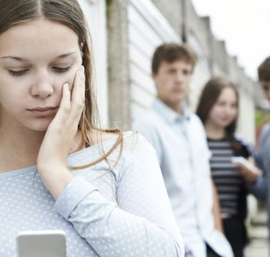 What should parents do when people harass their child online?