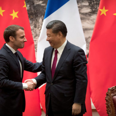 In China, Macron urges openness, pitches France Inc.