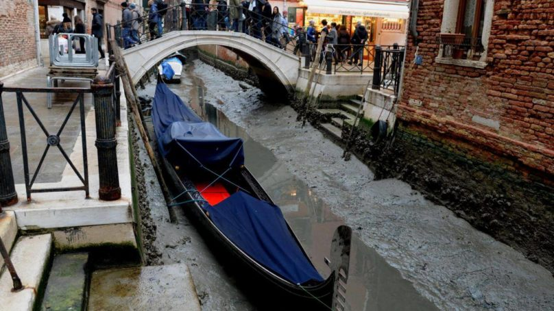 Venice canals dry up after super blue blood moon and low rainfall cause water levels to drop