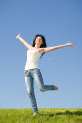 pretty-woman-jumping-green-grass-11646931