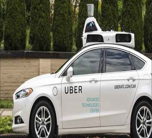 Toyota teams with Uber to develop driver-less vehicles