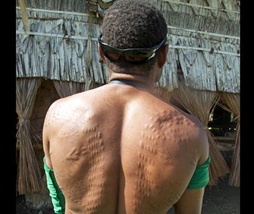 The island where men cut their skin to look like crocodiles