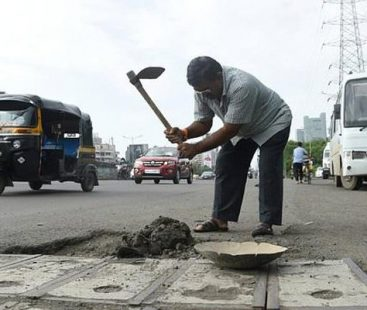 Bereaved father continues to fill 600 potholes in India in the memory of his deceased son
