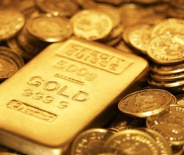 Gold holds gain as US dollar eases