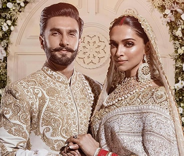 Deepika, Ranveer look stunned in coordinated ivory and gold outfits at Mumbai reception