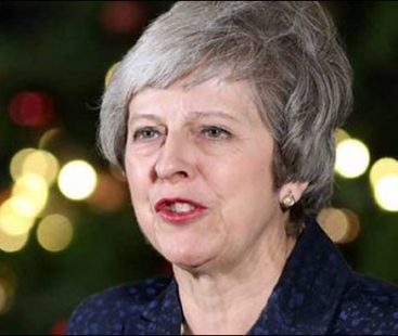 British PM Theresa May survives a confidence vote by her own MPs, losing support of one third of her colleagues