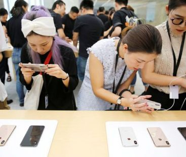 Apple dips iPhone prices as rising dollar hurts sales