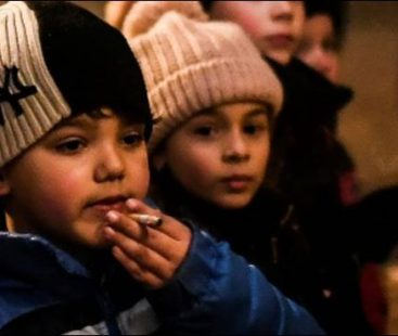 Kids encouraged to smoke cigarettes during a Portuguese festival