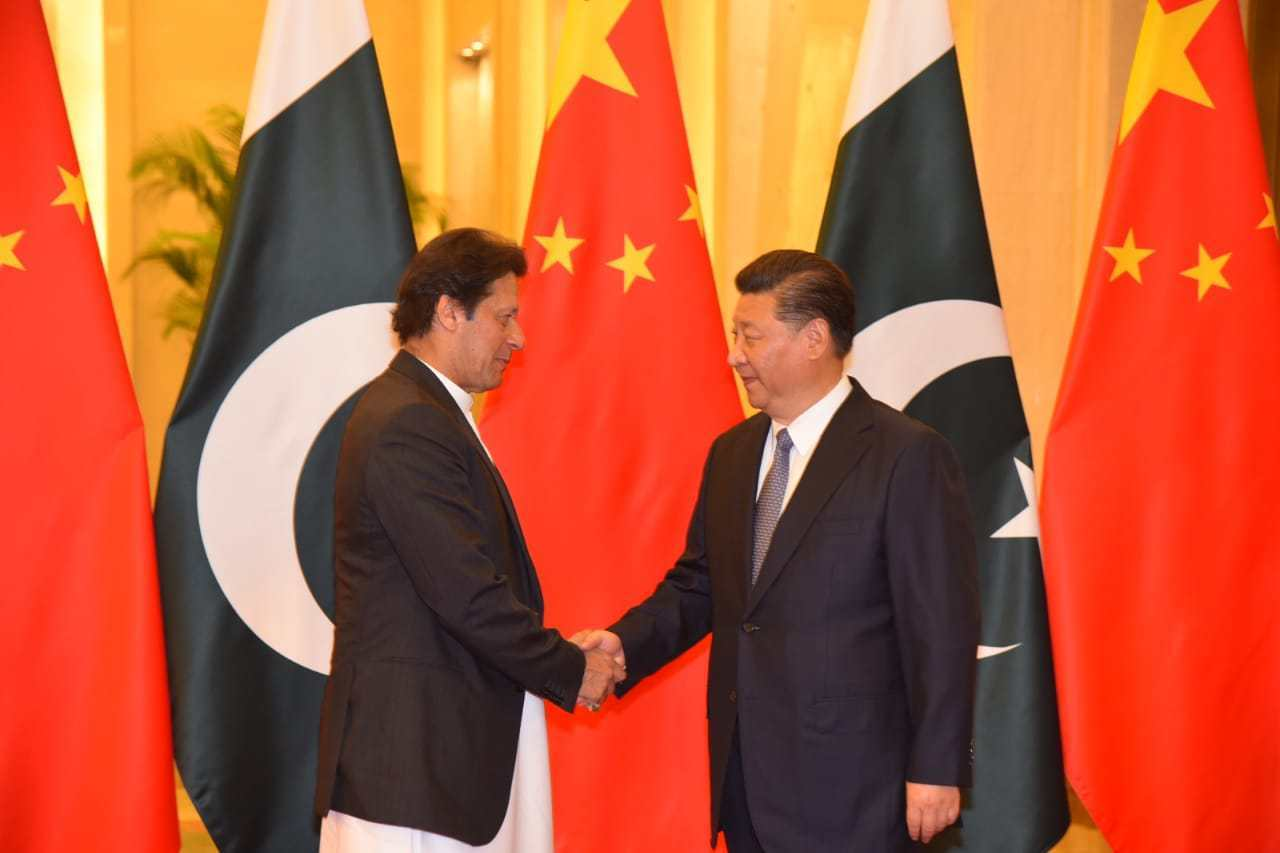 Imran Khan Xi jinping hand shake