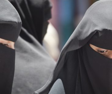 Students forced to take off burqas outside college
