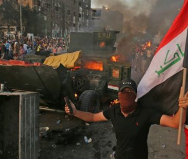Thousands in bloody protests across Iraq, 31 dead