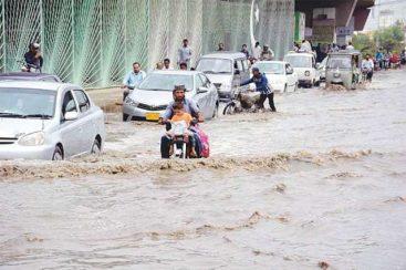 Heavy rains in Karachi meet choked drains