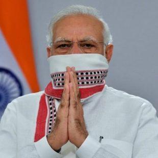 Modi urges Indians to keep up masks, distancing